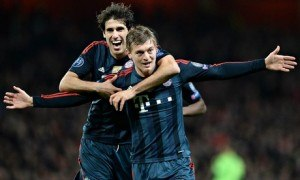 Toni Kroos celebrates after scoring as Bayern knocked Arsenal out of the 2013/14 Champions League.