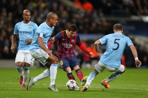 Three Man City players try in vain to stop Lionel Messi in a previous Champions League encounter.