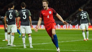 Eric Dier celebrates scoring the 91st minute winner against Germany one year ago.