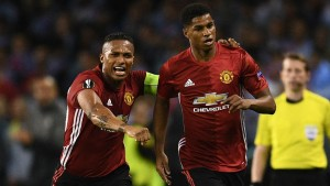 Marcus Rashford and Antonio Valencia seconds after the young England striker scored against Celta Vigo.